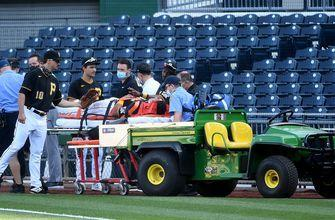 Phillip Evans taken off on stretcher after nasty collision with Gregory Polanco