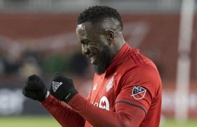 Altidore carries Toronto FC over New England in home opener