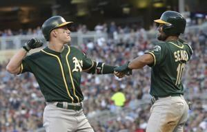 Davis' 2-out, 2-run single in 9th lifts A's over Twins 5-4