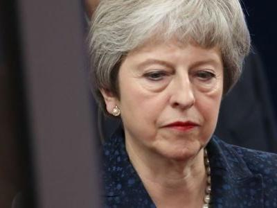 Theresa May suffers historic defeat after MPs reject her Brexit deal
