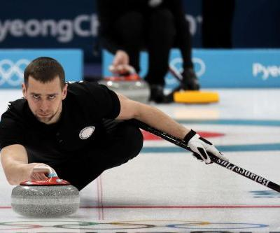 Russia bends to anger over curler's doping