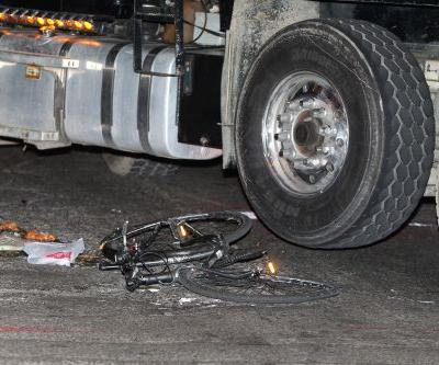Dump truck runs over, kills cyclist riding wrong way