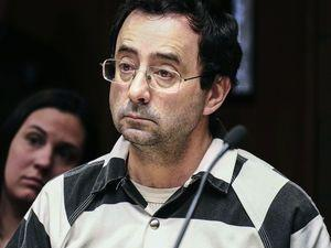 The Latest: Gymnastics doctor pleads guilty to sex charges