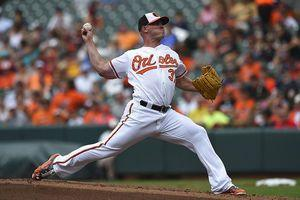Britton gets AL saves record as Orioles beat Astros 9-7