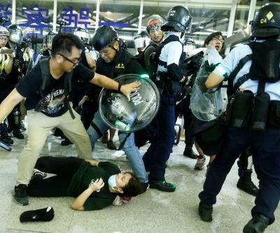 Protesters clash with riot police at Hong Kong airport