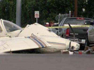 VIDEO: Small plane crashes into utility pole, cars before landing in the middle of a street