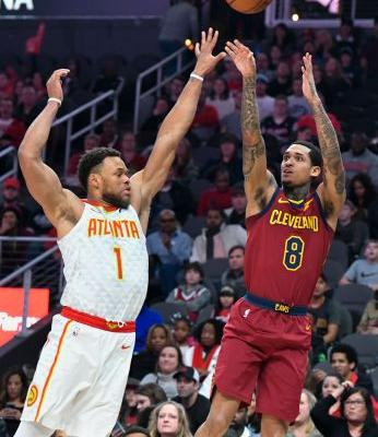 Young, Carter power Hawks past Cavs, 111-108