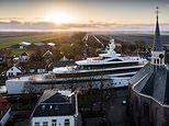 Pictured: The moment a new superyacht is VERY carefully manoeuvred along narrow Dutch canals