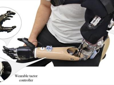 Design and Integration of an Inexpensive Wearable Mechanotactile Feedback System for Myoelectric Prostheses