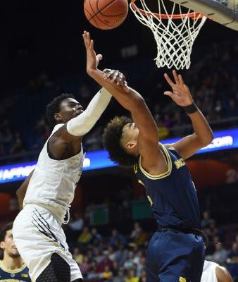 The Latest: No. 18 Michigan routs GW in Tip-Off tournament