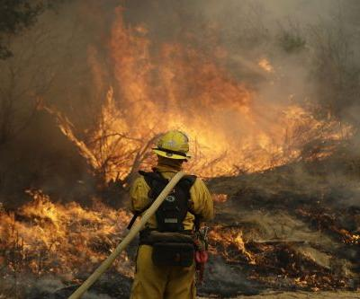 Hundreds flee homes as winds fan flames in California