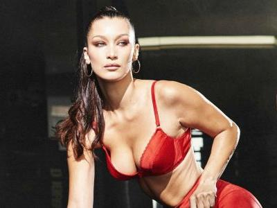 Watch Bella Hadid Take a Sledge Hammer To a Giant Tire For 'Love' Advent