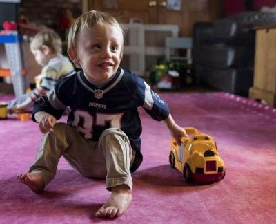Natick family tickled pink by new rug to help legally blind boy