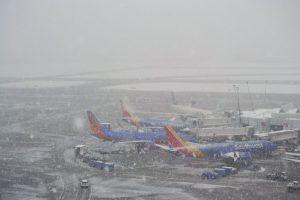 Hundreds of flights at Sea-Tac airport cancelled & delayed due to snow