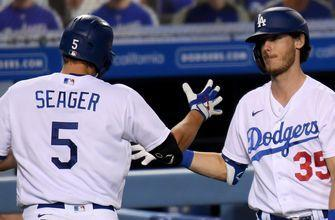 Dodgers club four homers and clinch NL West in 7-2 win over Athletics