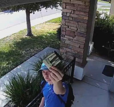 Surveillance video shows teen returning wallet stuffed with $1,500 in cash
