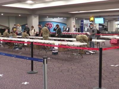 Air travelers returning to New England airport offered free COVID-19 testing