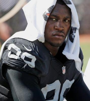 Police search for NFL's Aldon Smith in domestic abuse case