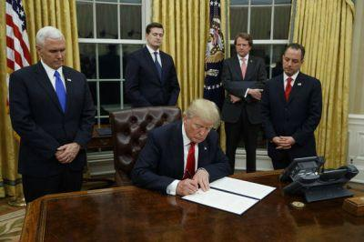 On first day, Trump signs health care executive order