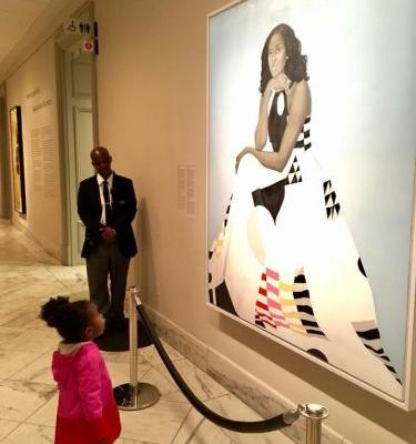 The girl that went viral for staring at Michelle Obama's portrait dressed up as her for Halloween, and perfectly recreated her outfit