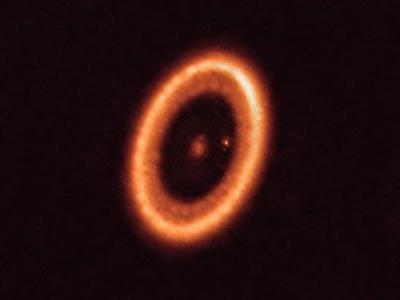 This photo of a moon-forming disc around an exoplanet puts Saturn to shame