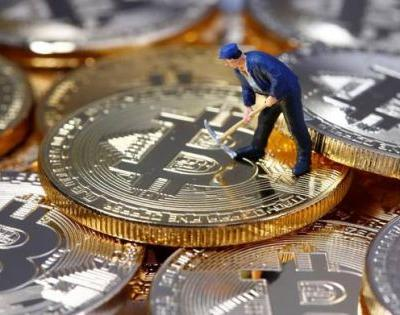 Bitcoin sinks to new 13-month low