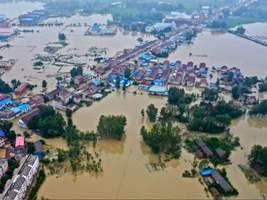 Massive flood in central China leaving 12 dead and more than 100,000 evacuated