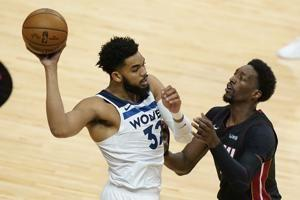 Heat move back into 6th in East, top Timberwolves 121-112