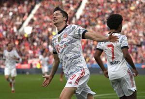 Bayern sends message to rivals with 5-1 win at Leverkusen