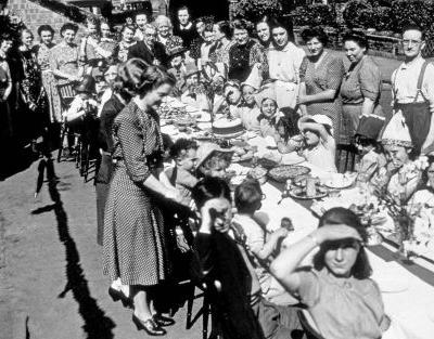 Sandwiches, eggless sponge cake and saved-up beer. how VE Day was celebrated at the table