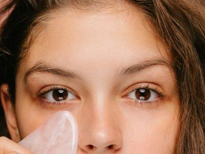 The Surprising Place To Gua Sha If You Have Forehead Lines